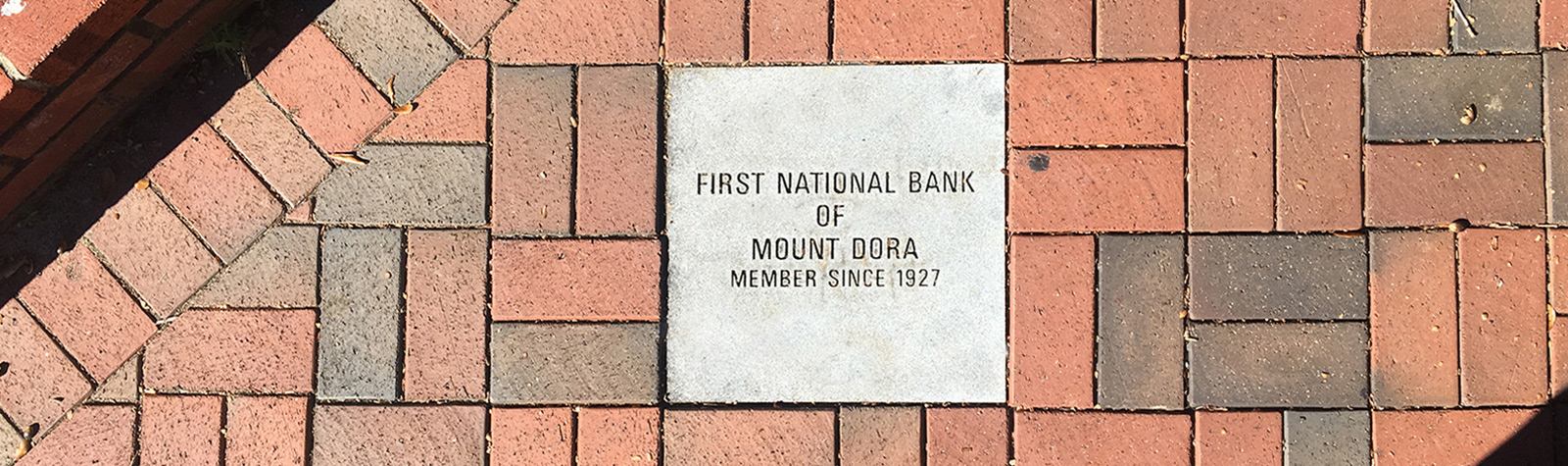brick paver with First National Bank of Mount Dora dates