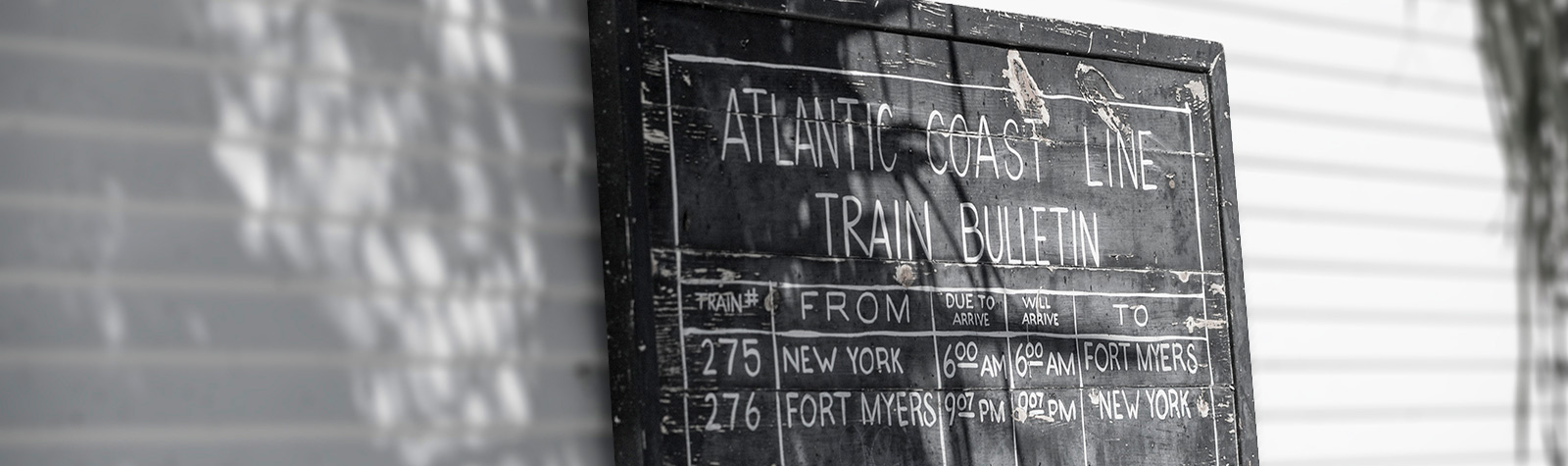 sign with information about the Atlantic Coast train schedule