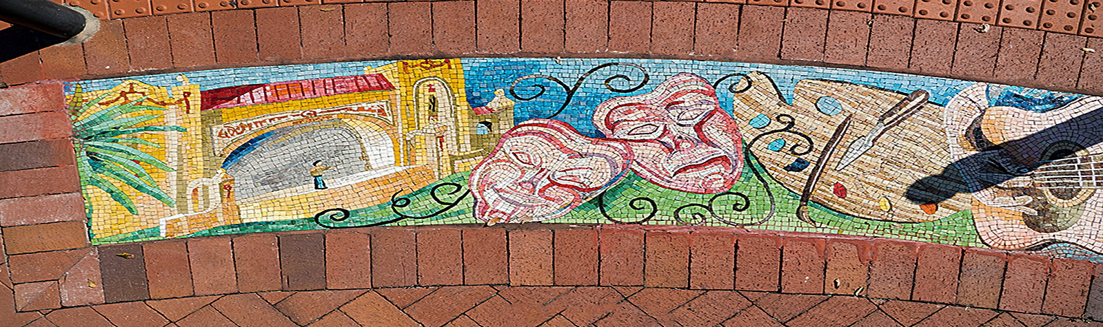 street mosaic illustrating the arts